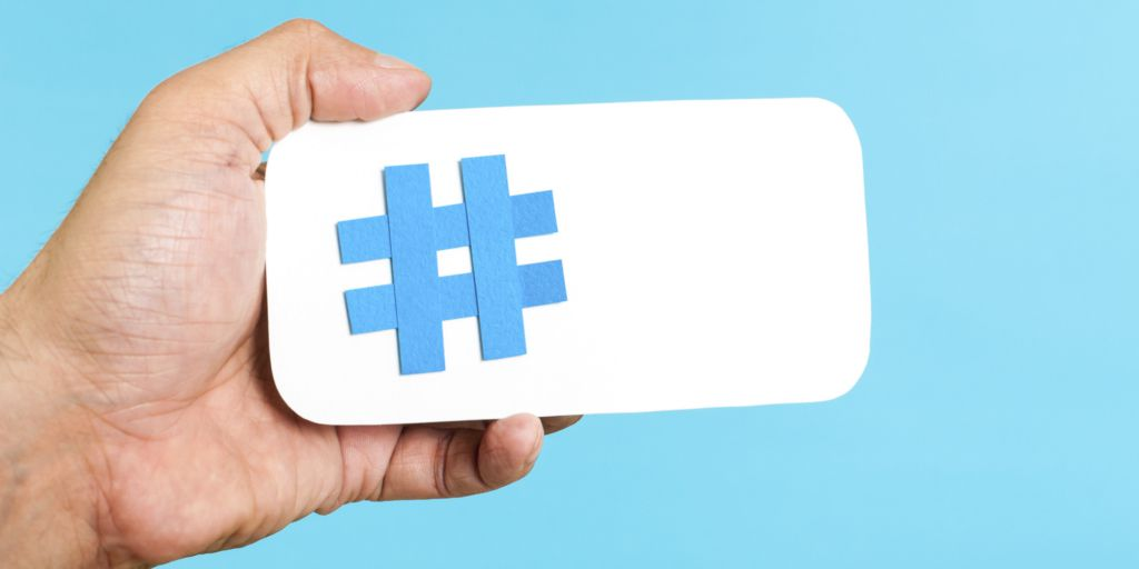 paper hashtag in hand