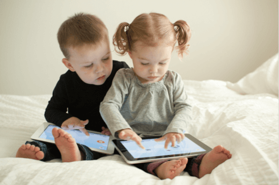 Kids playing ipad