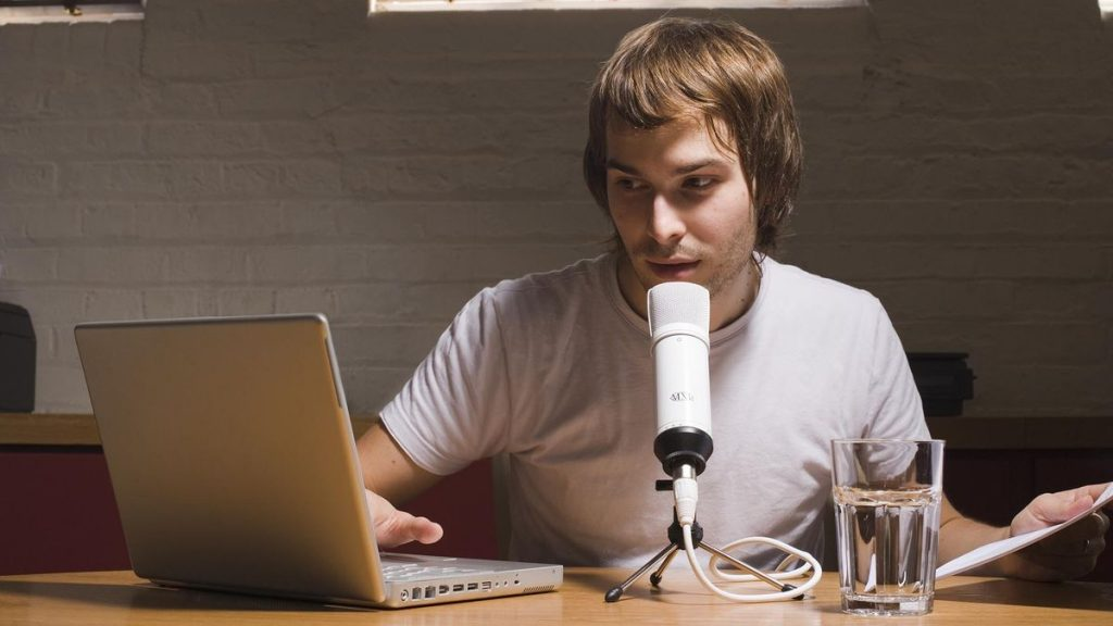 podcaster with laptop